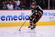 Nov 5, 2013; Glendale, AZ, USA; Phoenix Coyotes forward Martin Hanzal (11) skates on the ice in the second period against the Vancouver Canucks at Jobing.com Arena. The Coyotes defeated the Canucks 3-2 in an overtime shoot out. Mandatory Credit: Jennifer Stewart-USA TODAY Sports