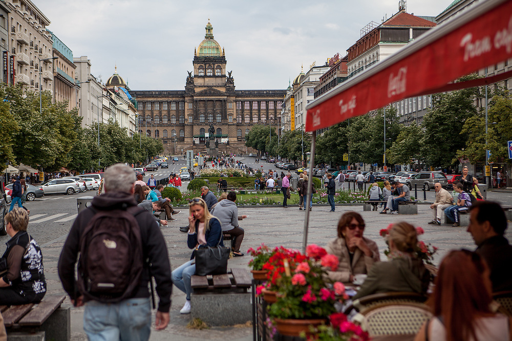 "Prague Wenceslas Square with the National Museum (Narodni Muzeum) and the Statue of St. Wenceslas in the back. One the right side ""Cafe Tram""."