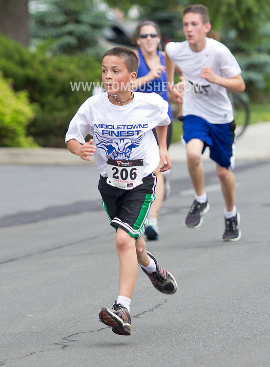 Middletown, New York - Thomas Leo, 10, sprints for the finish line in the 16th annual Ruthie Dino-Marshall 5K Run/Walk put on by the Middletown YMCA on Sunday, June 10, 2012.