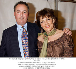 The DUKE & DUCHESS OF RUTLAND at a dinner in London on 20th May 2002.<br />PAF 198