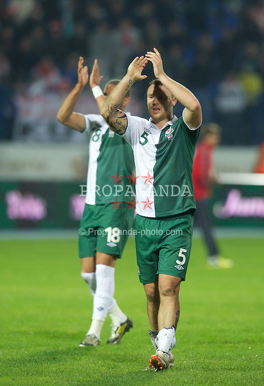 OSIJEK, CROATIA - Tuesday, October 16, 2012: Wales' Darcy Blake applauds the travelling supporters after his side's 2-0 defeat by Croatia during the Brazil 2014 FIFA World Cup Qualifying Group A match at the Stadion Gradski Vrt. (Pic by David Rawcliffe/Propaganda)