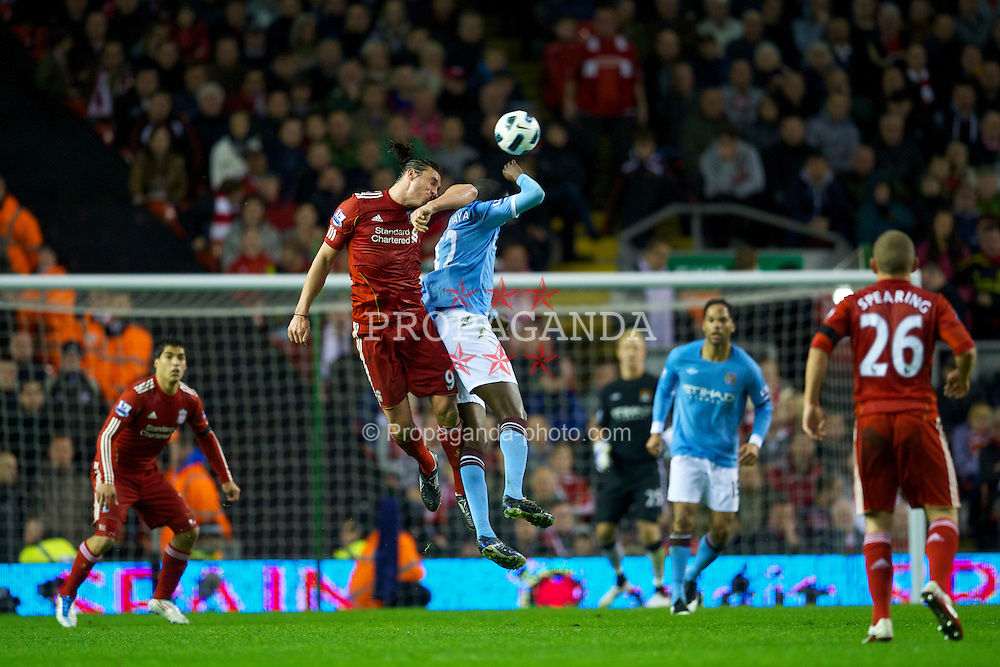 LIVERPOOL, ENGLAND - Monday, April 11, 2011: Liverpool's Andy Carroll in action against Manchester City during the Premiership match at Anfield. (Photo by David Rawcliffe/Propaganda)