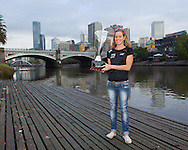 "Caroline Steffen (SUI) Pro Female Winner of the inaugural Ironman Melbourne Triathlon with the ""Michellie Jones Trothy"" and Melbourne city in the background.Post Race Trophy Shoot. 2012 Ironman Melbourne. Asia-Pacific Championship. 26/03/2012. Photo By Lucas Wroe."