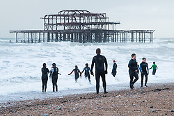 © Licensed to London News Pictures. 31/12/2015. Brighton, UK. Students from the Sea Rescue club take a break from their morning training session watched by their instructors. Today December 31st 2015. Photo credit: Hugo Michiels/LNP