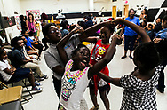 "September 21, 2017 - Angel Washington, center, participates in a ""twist"" game with her peers during vocal practice through the AngelStreet program at Bickford Community Center. AngelStreet serves youths in communities where art and music aren't being taught in schools. And African-American girls from North Memphis are using music and singing as a conduit to empowering themselves. (Yalonda M. James/The Commercial Appeal)"