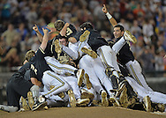 The Vanderbilt Commodores players celebrate after beating the Virginia Cavaliers 3-2 to win the College World Series Championship at TD Ameritrade Park in Omaha, Nebraska.