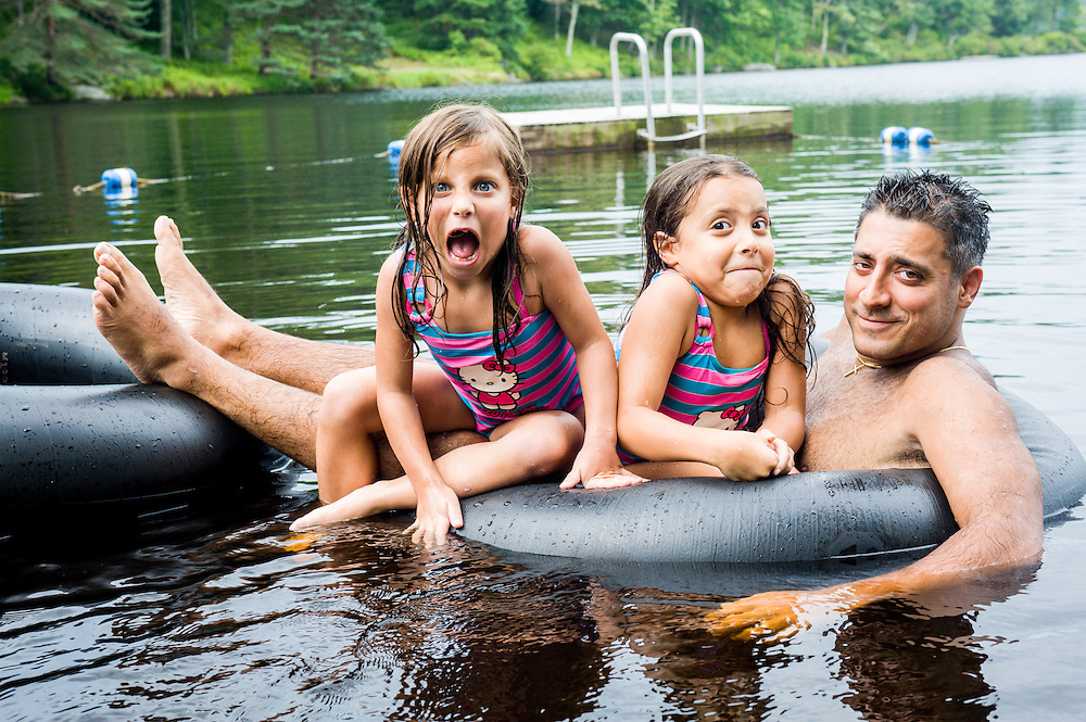A father with his two daughters in Lake Blue Heron, Poconos, PA.