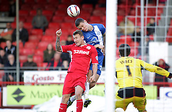 Peterborough United's Ben Nugent in action with Crawley Town's Kyle McFadzean - Photo mandatory by-line: Joe Dent/JMP - Tel: Mobile: 07966 386802 01/03/2014 - SPORT - FOOTBALL - Crawley - Broadfield Stadium - Crawley Town v Peterborough United - Sky Bet League One