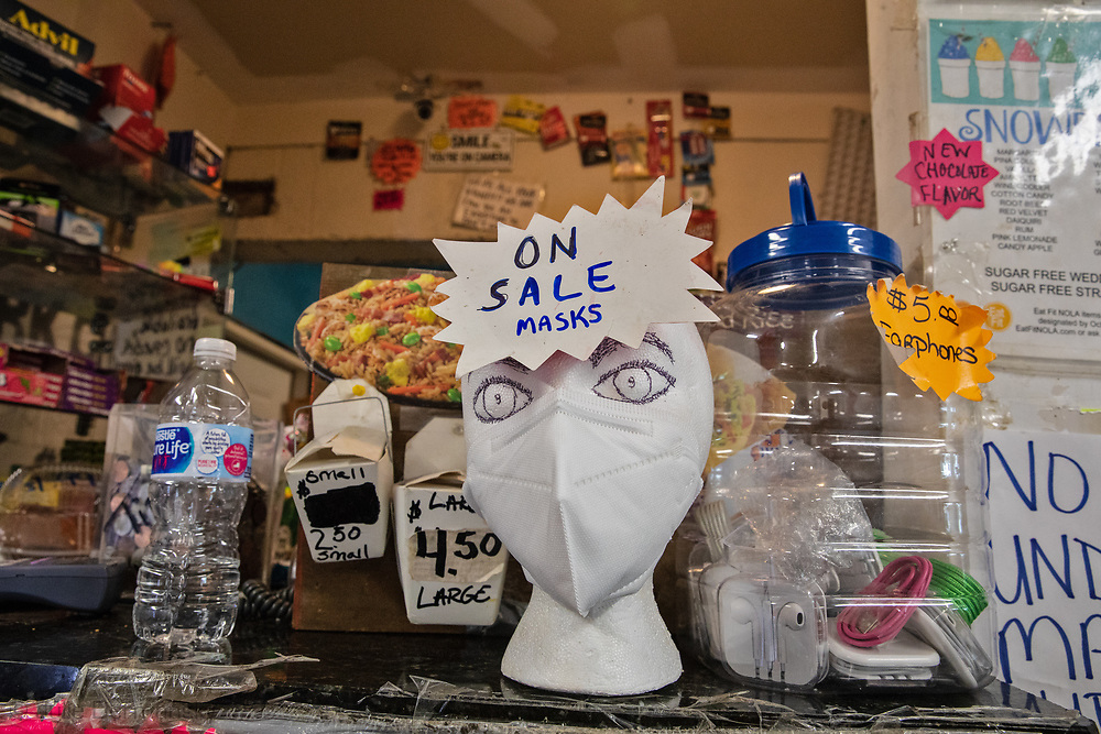 Masks for sale at  Burnell's Lower 9th Market in New Orleans which remains open despite the coronavirus pandemic..