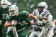 Burlington's Kevon Garrison (2) tackles Rice's Cavan Lamontage (26) during the high school football game between the Burlington Seahorses and the Rice Green knights at Rice High School on Saturday afternoon September 9, 2017 in South Burlington. (BRIAN JENKINS/for the FREE PRESS)