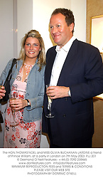 The HON.THOMAS NOEL and MISS OLIVIA BUCHANAN-JARDINE a friend of Prince William, at a party in London on 7th May 2003.	PJJ 201