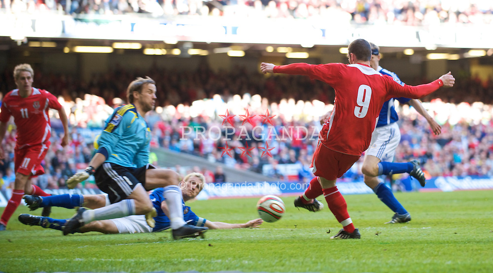 CARDIFF, WALES - Saturday, March 28, 2009: Wales' Jason Koumas sees his shot saved by Finland's goalkeeper Jussi Jaaskelainenduring the 2010 FIFA World Cup Qualifying Group 4 match at the Millennium Stadium. (Pic by David Rawcliffe/Propaganda)