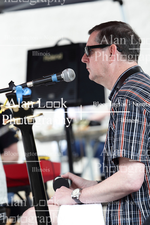 11 July 2015:  Three members including Chris Briggs and Marc Boone of the group Marc Boon and the Unknown Legends perform for the festival comers at the 2015 Sugar Creek Arts Festival in Uptown Normal Illinois