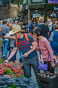 The vegetable stalls draw custom again - The market reopening is signified by the ringing of the bell and is attended by Mayor Sadiq Khan. Tourists and locals soon flood back to bring the area back to life. London 14 Jun 2017