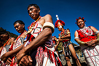 Tribes from across the region gather for the Hornbill Festival in Nagaland, India. The festival takes place over 7 days during the first week of December, and is a showcase of the various histories and cultures of the region. By some estimates, as much as 90% of the tribes are Christian (Baptist mostly). Here, tribesmen and women bow their heads in silent prayer during the opening cermonies of the festival.