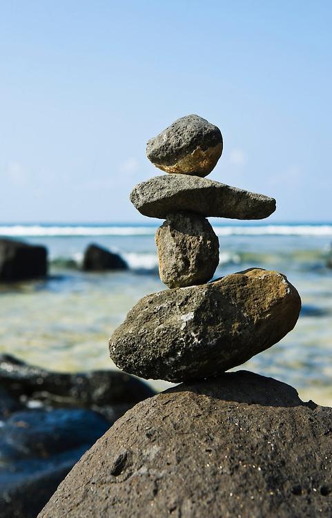 Rock stack on shore near Moloa'a bay, Kauai, Hawaii, USA.