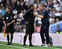 Football - 2019 / 2020 Premier League - Tottenham Hotspur vs. Aston Villa<br /> <br /> Aston Villa manager Dean Smith remonstrates with Fourth Official Tim Robinson, at The Tottenham Hotspur Stadium.<br /> <br /> COLORSPORT/ASHLEY WESTERN