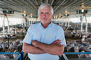 Farmer Ken Ries stands for a portrait inside his hog farm in Ryan, Iowa, U.S. May 18, 2019. Picture taken May 18, 2019.  REUTERS/Ben Brewer