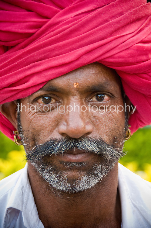 Portrait of man in huge red turban, with mustache and beard, Mt. Abu, India.