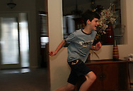 Cody races around his Westchase home