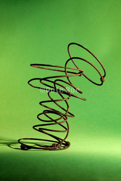 intertwined broken rusty springs