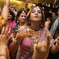 Seven-hundred guests gather at a five-star hotel in New Delhi for one of twelve functions to celebrate the marriage of a Sikh couple. Weddings in India have generally always been indulgent afairs but the increasingly aspirational urban classes are spending ever greater sums of money. Some families, including those at this wedding, employ a wedding-planner to coordinate events...Photo: Tom Pietrasik.New Delhi, India..September 30th 2006.