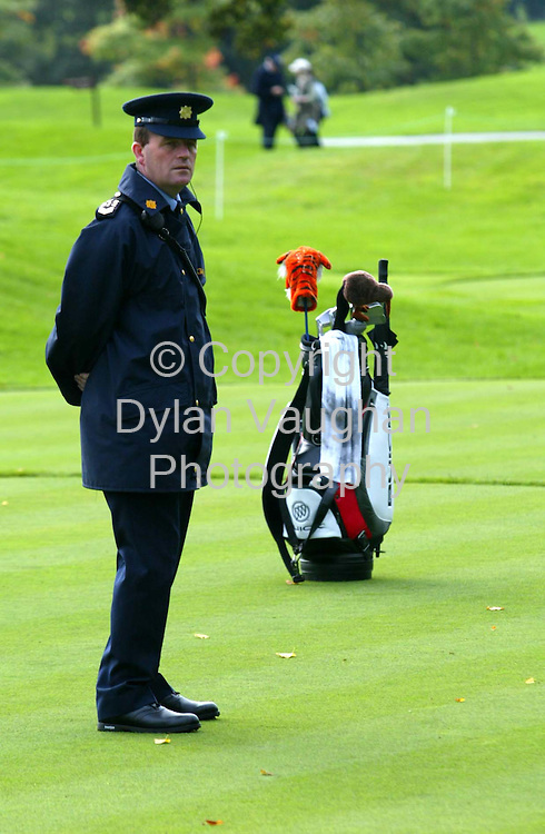 28/9/2004.A Garda keeps gaurd over Tigers bag at the first yesterday at the World Golf Championships in Mount Juliet Conrad..Picture Dylan Vaughan
