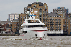 "© Licensed to London News Pictures. 16/06/2018. London, UK.  Bruce Grossman's 180 feet long superyacht, Forever One sails on the River Thames in London before passing under Tower Bridge. Bruce Grossman is one of the richest men in Mexico (estimated net worth of USD1.5 billion) and shareholder of Arca Continental, the second largest Coca-Cola bottler in Latin America and third largest in the world. The unusual red colour scheme of the yacht reflects Grossman's significant Coca-Cola business interests and the yacht also features a reverse bow, fold-down balconies and a beach club with large window in the transom. The name Forever One refers to Bruce's wife Elsa, the childhood best friend of his younger sister and who later became Grossman's ""forever one""..  Photo credit: Vickie Flores/LNP"