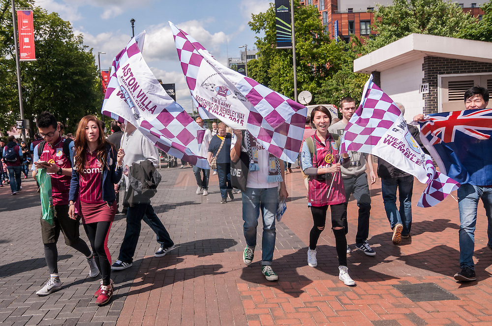 © Licensed to London News Pictures. 30/05/2015. London, UK. Aston Villa fans wave a flag, as fans gather at Wembley Stadium for the FA Cup Final 2015, between Arsenal and Aston Villa. Photo credit : Stephen Chung/LNP
