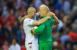 13.09.2014, Anfield, Liverpool, ENG, Premier League, FC Liverpool vs Aston Villa, 4. Runde, im Bild Aston Villa's Philippe Senderos and goalkeeper Brad Guzan celebrate their side's 1-0 victory over Liverpool // during the English Premier League 4th round match between Liverpool FC and Aston Villa at Anfield in Liverpool, Great Britain on 2014/09/13. EXPA Pictures © 2014, PhotoCredit: EXPA/ Propagandaphoto/ David Rawcliffe<br /> <br /> *****ATTENTION - OUT of ENG, GBR*****