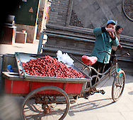 vendor in the ancient walled-city of Pingyao<br /> Shanxi, China