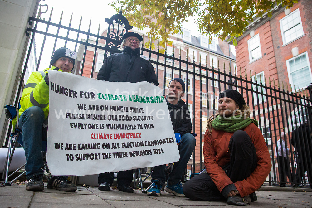 London, UK. 19 November, 2019. Hunger striking climate activists from Extinction Rebellion assemble outside the Conservative Party headquarters on the second day of an 'Election Rebellion' hunger strike with three demands for election candidates: to tell the truth by declaring a Climate and Ecological Emergency, to promote policies to halt biodiversity loss and reduce greenhouse gas emissions to net zero by 2025 and to help the Government create and be led by a Citizen's Assembly on climate and ecological justice.
