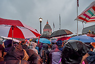 Rain falls and umbrellas go up as the crowd, which has gathered for the rally, turns to begin its march in the San Francisco Women's March on January 21st.