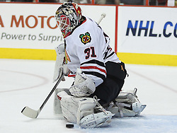 June 9, 2010; Philiadelphia, PA; USA; Chicago Blackhawks goalie Antti Niemi (31) makes a save during the first period of Game 6 of the Stanley Cup Finals against the Philadelphia Flyers at the Wachovia Center.