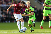 Northampton Towns Jack Bridge(19) holds off Forest Green Rovers Isaac Pearce(17) during the EFL Sky Bet League 2 match between Northampton Town and Forest Green Rovers at Sixfields Stadium, Northampton, England on 13 October 2018.
