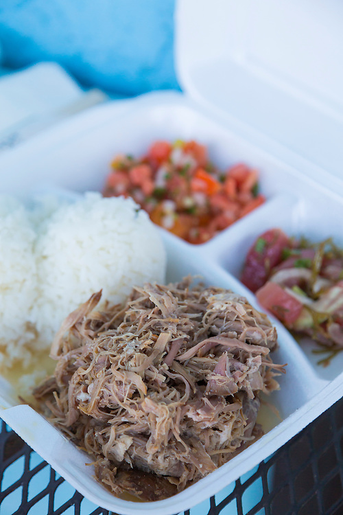 Yama's Fish Market in downtown Honolulu offers great take-out plate lunch with classic dishes like kalua pork, ahi poke and lomi-lomi salmon served in styrofoam containers, Oahu, Hawaii