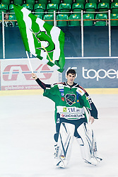 Matic Boh (HDD Tilia Olimpija, #20) with flag during ice-hockey match between HDD Tilia Olimpija and SAPA Fehervar AV19 at sixth match in Quarterfinal  of EBEL league, on March 1, 2012 at Hala Tivoli, Ljubljana, Slovenia. HDD Tilia Olimpija won 4:3 and advanced to semifinal. (Photo By Matic Klansek Velej / Sportida)