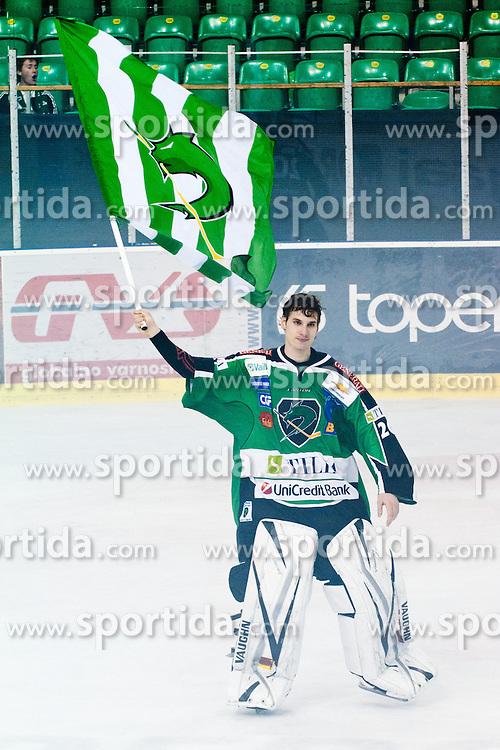 Matic Boh (HDD Tilia Olimpija, #20) with flag during ice-hockey match between HDD Tilia Olimpija and SAPA Fehervar AV19 at sixth match in Quarterfinal  of EBEL league, on March 1, 2012 at Hala Tivoli, Ljubljana, Slovenia. HDD Tilia Olimpija won 4:3 and advanced to semifinal. (Photo By Matic Klansek Velej / Sportida)