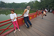 Hoan Kiem Lake. Morning sports on The Huc Bridge to Ngoc Son (Jade Mountain) Temple.