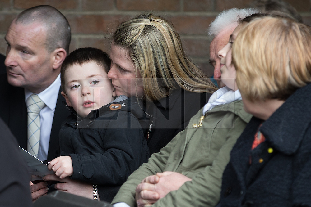 © Licensed to London News Pictures . 29/03/2015 . Manchester , UK . Rebecca Rigby ( Lee Rigby's widow ) and son Jack at the memorial service . A bronze drum , in memory of Fusilier Lee Rigby , is unveiled in Middleton Memorial Gardens , North Manchester at a memorial service in his honour . Rigby was murdered in a terrorist attack in Woolwich in May 2013 . Photo credit : Joel Goodman/LNP