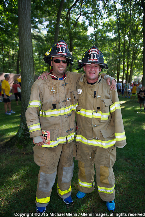22 Aug 2015 Gillie Park New Jersey US  // Chris Arrienta and Scott  Circovich from Barnegat Vol Fire Company station 11 completed the  Lacey Municipal Alliance annual 5K at Gillie park dressed in full gear // ©2015 Michael Glenn / Glenn Images, all rights reserved