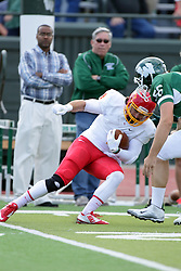 19 September 2015:  Nate Connealy encounters James Burnell during an NCAA division 3 football game between the Simpson College Storm and the Illinois Wesleyan Titans in Tucci Stadium on Wilder Field, Bloomington IL