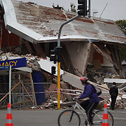 An earthquake damaged building in Christchurch after a Powerful earth quake ripped through Christchurch, New Zealand on Tuesday lunch time killing at least 65 people as it brought down buildings, buckled roads and damaged churches and the Cities Cathedral. Photo Tim Clayton