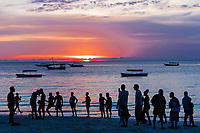 people enjoying on the beach at Sunset  n Unguja aka Zanzibar Island Tanzania East Africa