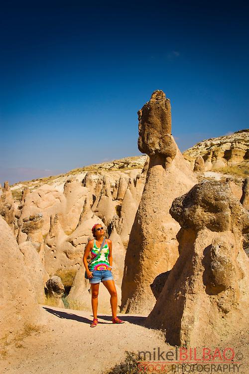 Woman and Fairy chimneys in Devrent Valley. Cappadocia, Turkey.