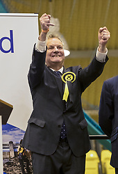 The count for the UK Parliamentary General Election 2017 for the Perth & North Perthshire Constituency takes place at Bell's Sports Centre in Perth.<br /> <br /> The four candidates standing for the seat are Peter Barrett (Scottish Liberal Democrats), Ian Duncan (Scottish Conservatives), David Roemmele (Scottish Labour) and Pete Wishart (SNP)<br /> <br /> Pictured: After two re-counts the result of Perth and North Perthshire is announced with Pete Wishart retaining the seat with 21,804 votes. Ian Duncan (Conservative) trailed by 21 votes with 21,783. David Roemmele (Labour) third with 5,349 and Peter Barrett (Liberal Democrats) fourth with 2,589