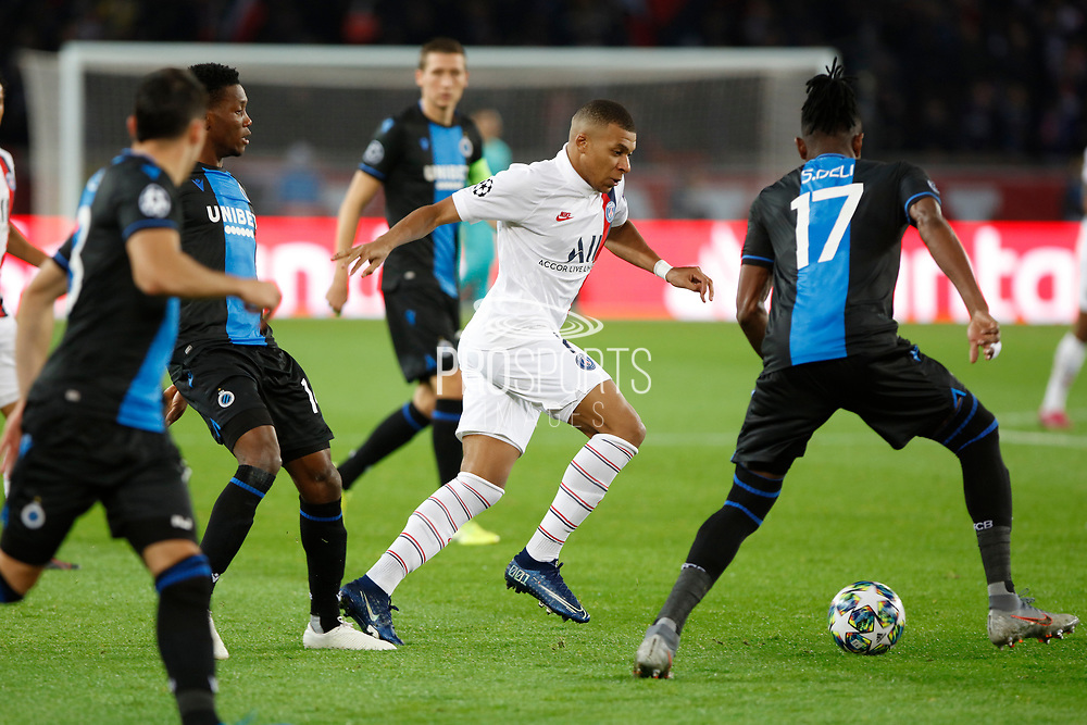 Kylian Mbappe of PSG in action against Simon Deli of Club Brugge during the UEFA Champions League, Group A football match between Paris Saint-Germain and Club Brugge on November 6, 2019 at Parc des Princes stadium in Paris, France - Photo Mehdi Taamallah / ProSportsImages / DPPI