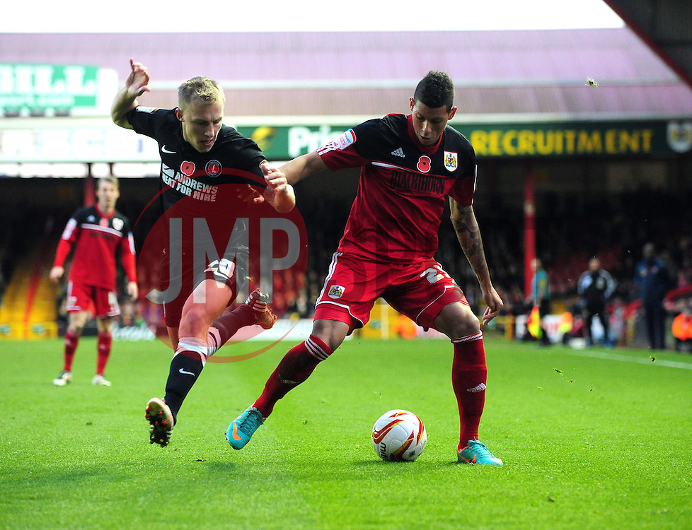 Bristol City's Matthew Briggs battles for the ball with Charlton Athletic's Chris Solly - Photo mandatory by-line: Joe Meredith/JMP  - Tel: Mobile:07966 386802 11/11/2012 - Bristol City v Charlton Athletic - SPORT - FOOTBALL - Championship -  Bristol  - Ashton Gate Stadium -