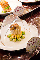 The Zhejiang region sets out sample dishes of their cuisine on display so potential restaurant patrons can order easily.