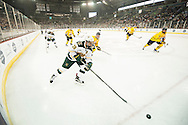 Vermont's Anthony Petruzzelli (28) skates with the puck during the men's hockey game between the Vermont Catamounts and the Quinnipiac Bobcats in the championship game of the Friendship Four hockey tournament at the SSE Arena on Saturday evening November 26, 2016 in Belfast, Ireland. (BRIAN JENKINS/for the FREE PRESS)